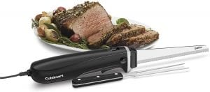 black electric knife with ham in the background