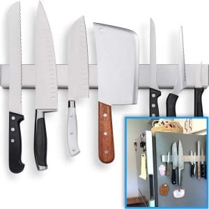 Fridge Applicable 17 Inch Stainless Steel Magnetic Knife Holder, with knives on the side of a refrigerator