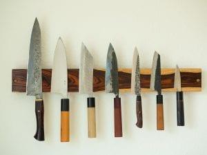Kitchen utensils on a magnetic knife strip