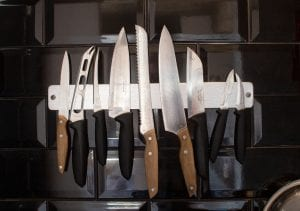 Knives on a metal magnetic knife bar