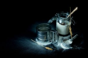 metal flour sieve and measuring cup