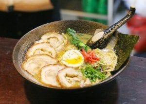 Beni shoga or pickled radish on a bowl of ramen, with chashu, ajitama, aonegi, nori