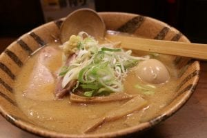 Shiraga negi or julienned green onions on a bowl of miso ramen