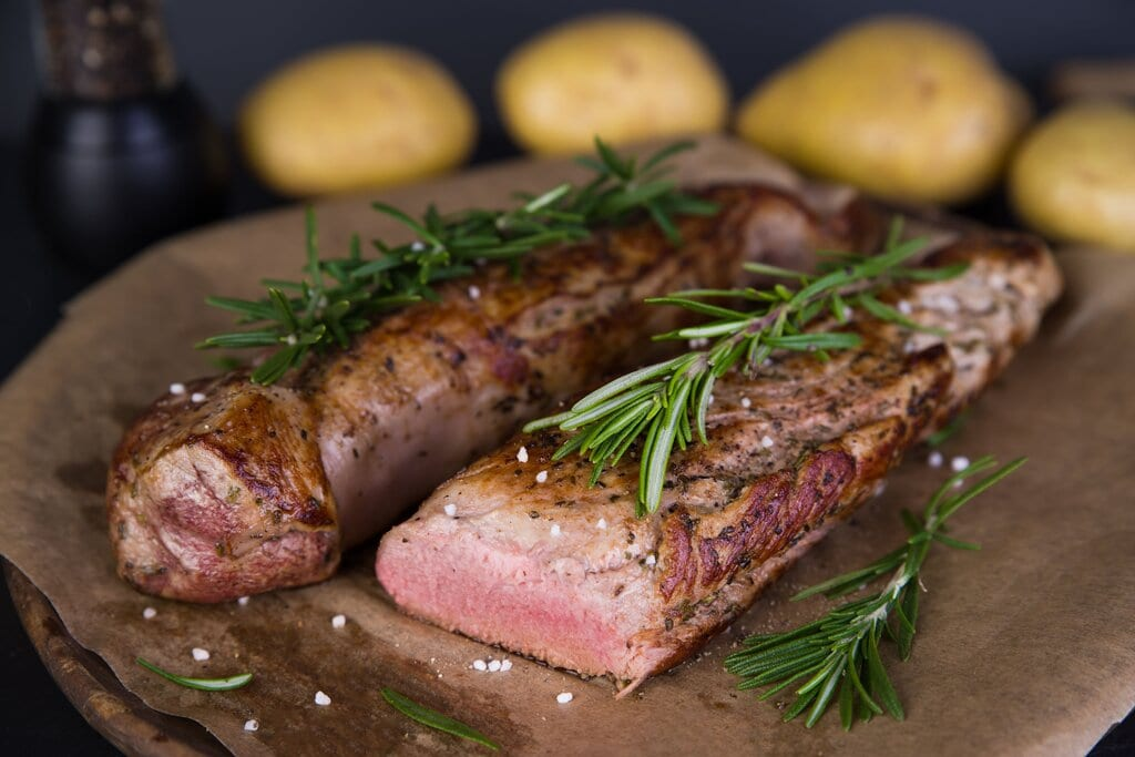 Sous Vide Pork Tenderloin Recipe, firm juicy medium rare pork loin sous vide with fresh herbs