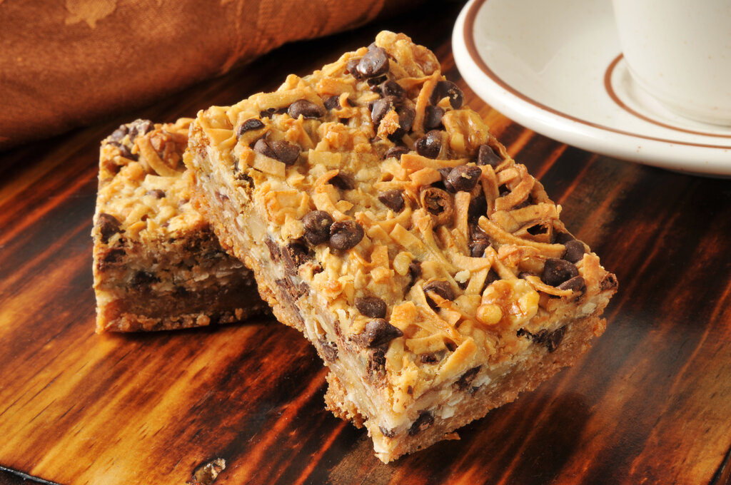 Hello Dolly Bars Recipe, dellicious dessert bars filled with chocolate chips, butterscotch chips, coconut, and walnuts, chunky magic cookie bars