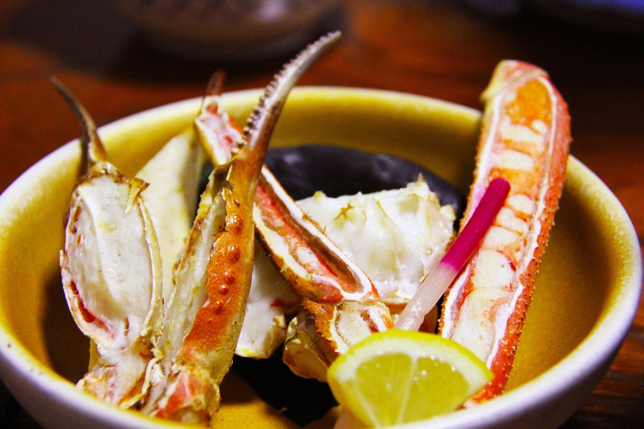 close-up shot of grilled crab legs with lemon
