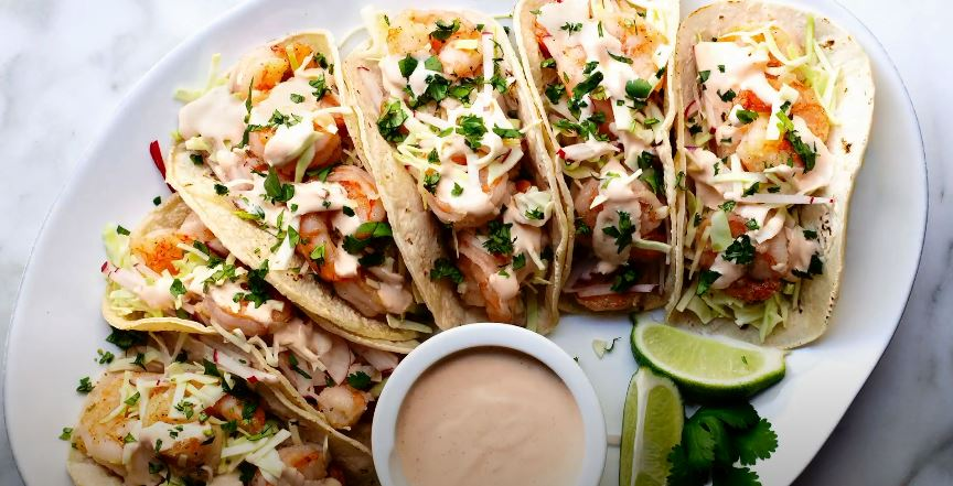 street-style shrimp tacos with corn, bacon and lime crema recipe